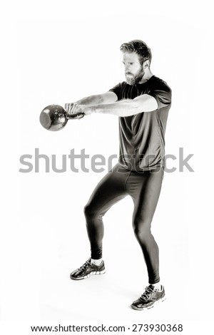 A shot of an athlete doing kettle bell workout - stock photo