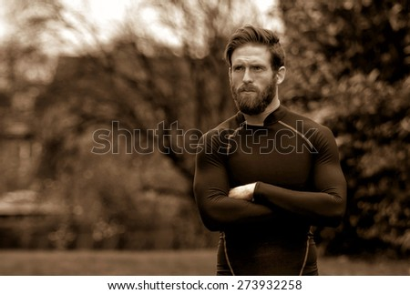 A shot of an athlete in a moody pose - stock photo