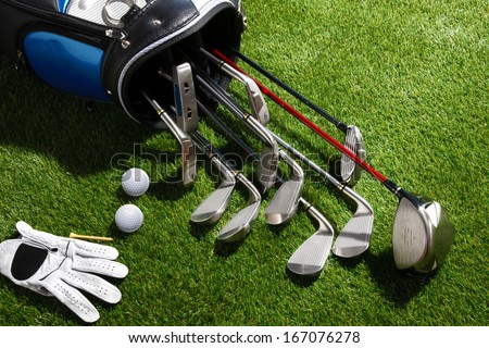 A shot of Golf balls,glove,tee,and clubs in the bag - stock photo