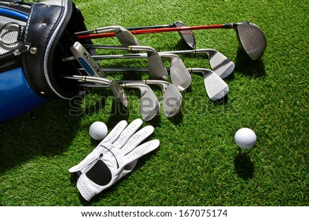 A shot of Golf glove,ball and clubs in bag - stock photo