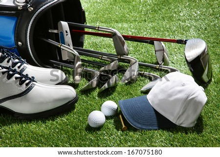 A shot of Golf shoes,hat,balls,tee and clubs in bag - stock photo