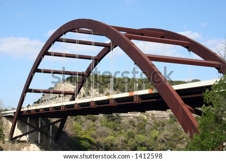A shot of the Austin 360 Bridge on a clear calm day.  This is a very pretty picture of the bridge and a great symbol of Austin, Texas. - stock photo