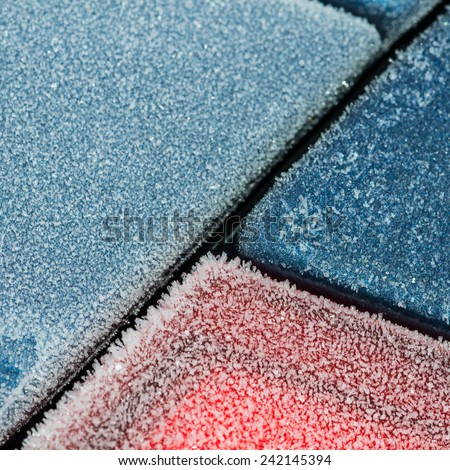 A shot of the frost covered surfaces of a car. - stock photo