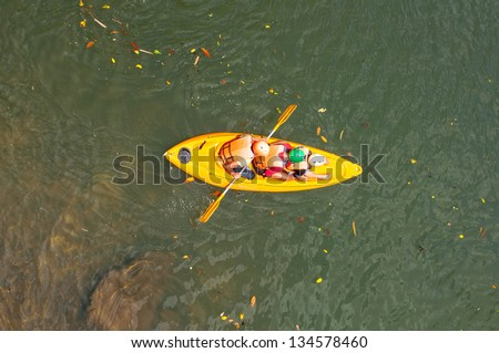a shot of the kayaker with an oar on the water ,Thailand - stock photo