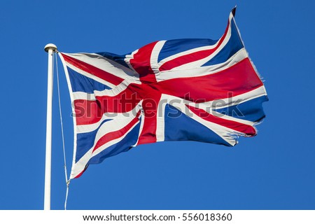 A shot of the Union Flag flying over a clear blue sky.