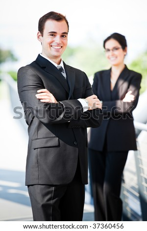 A shot of two happy business people standing outdoor - stock photo