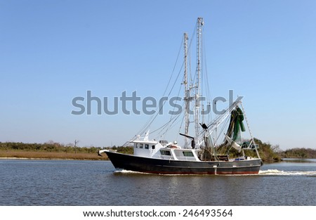A shrimp steel shrimp trawler boat returns to port on Bayou Lafourche in Southern Louisiana.