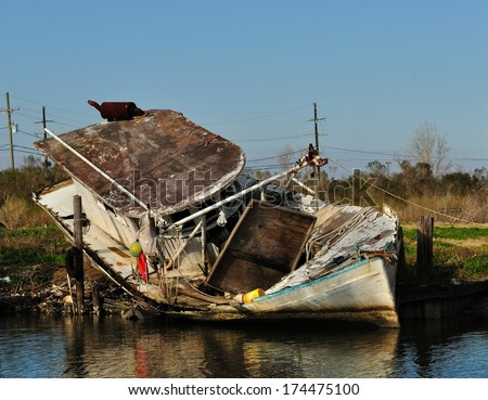 A Shrimp Trawler Boat Wrecked And Grounded On A Louisiana Bayou In The Aftermath Hurricane Katrina - stock photo