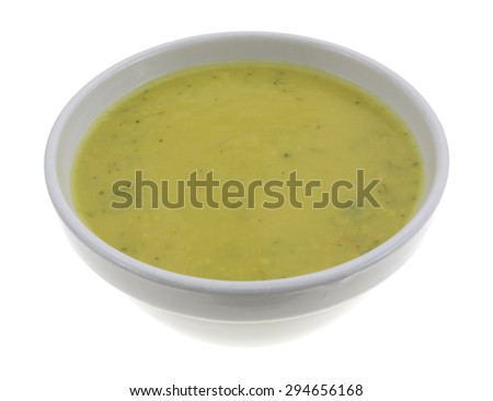 A side view of a bowl of broccoli cheese soup on a white background. - stock photo