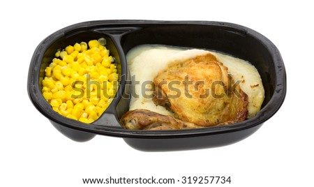 A side view of a frozen  roasted chicken and vegetable TV dinner. - stock photo