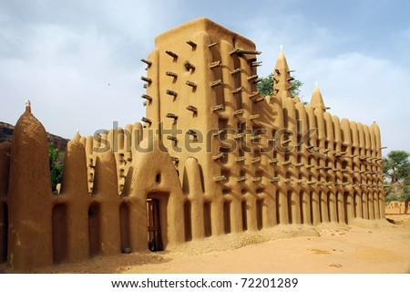 A side view of a mud mosque in a Dogon village in Mali - stock photo