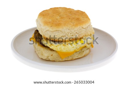A side view of a prepared breakfast sandwich on a plate. - stock photo