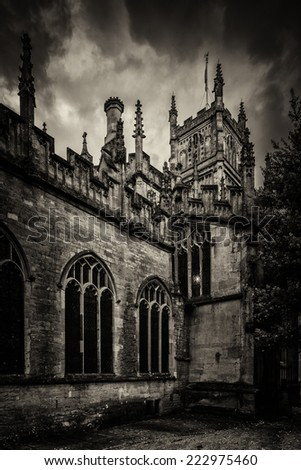 A side view of cirencester parish church located in the center of the beautiful cotswold town of cirencester .The second roman capital of great britain know as corinium