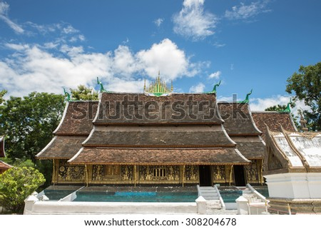 A side view of wat Xieng Thong in Luang Prabang , Laos - stock photo