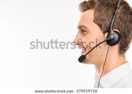 a side-view portrait of young smiling agent of call-centre - stock photo