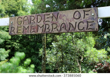 A sign above the entrance to a garden of remembrance where the dead are laid to rest.