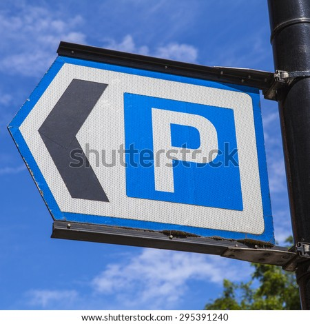 A sign directing vehicles to the nearest Car Park. - stock photo