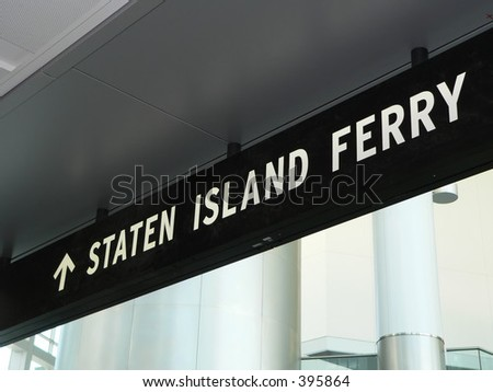 A sign directs riders to the Staten Island Ferry loading dock in the newly built terminal in Manhattan, New York City.