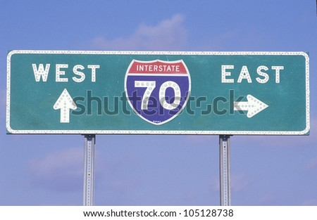 A sign for interstate 70 west and east - stock photo