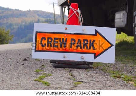 A sign indicates where crew for a film shoot can park/Movie Shoot Location Sign/A sign indicates where crew for a film shoot can park.