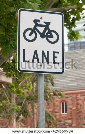 A sign indicating a dedicated bicycle lane is available for cyclists
