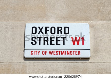 A sign on a street wall for Oxford Street in Central London - stock photo