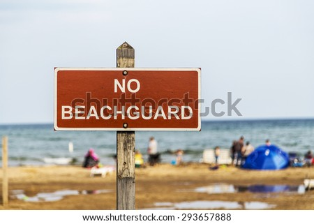 A sign on the beach in East Tawas state park in Michigan - stock photo
