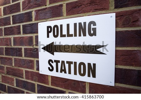 A sign outside a Polling Station on election day in the UK. - stock photo