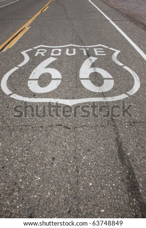 "A sign reading ""Route 66"" is stenciled on the highway on a stretch of road that was once Route 66."