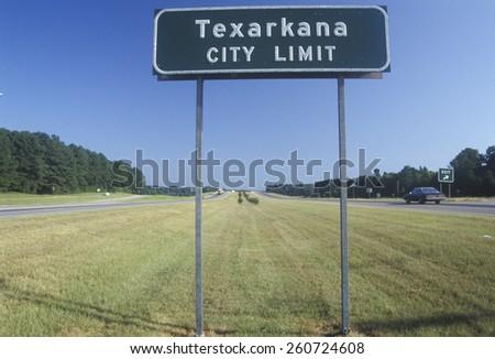 A sign reads Texarkana, Texas - stock photo