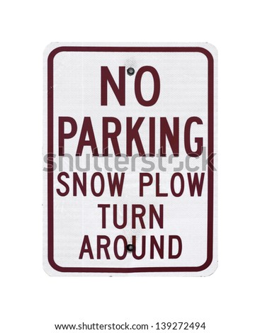 A sign stating No Parking Snow Plow Turn Around. - stock photo
