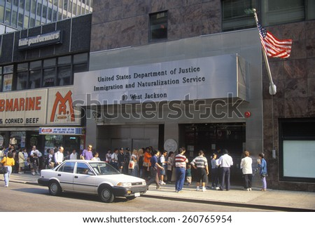"""A sign that reads """"?United States Department of Justice Immigration and Naturalization Service"""" where new American citizens are sworn into citizenship. - stock photo"""