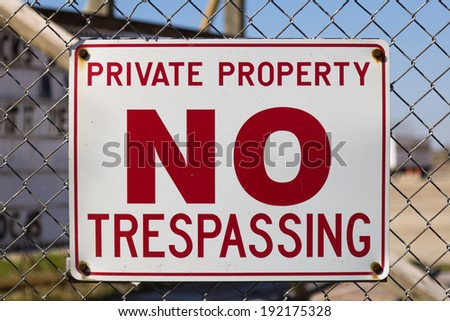 A sign warning that the area is private property and no trespassing allowed - stock photo