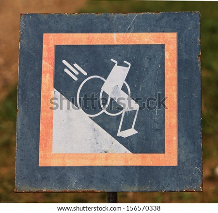 A sign warning that the hill is dangerous for wheelchairs - stock photo