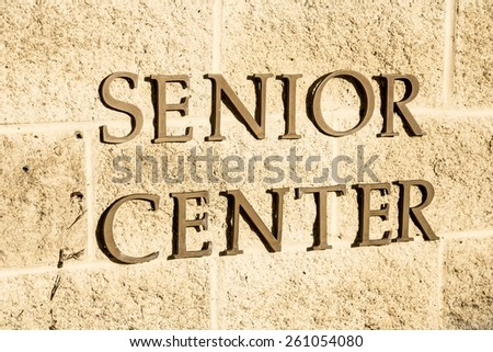A sign with the words Senior Center on it. - stock photo