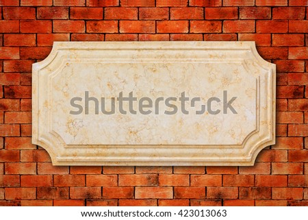 A signboard marble on old brick wall.