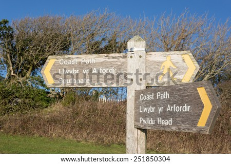 A signpost for the Wales Coast Path between Southgate and Pwlldu Head on the Gower, South Wales, UK - stock photo