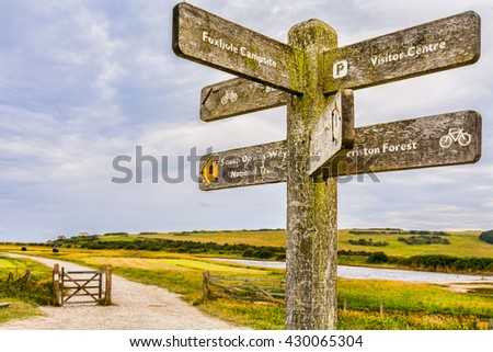 A signpost on the South Downs Way near Cuckmere Haven in Sussex, England. This is in the Seven Sisters Country Park. - stock photo