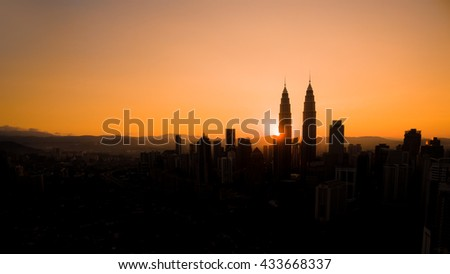 A silhouette aerial view of Kuala Lumpur during sunrise