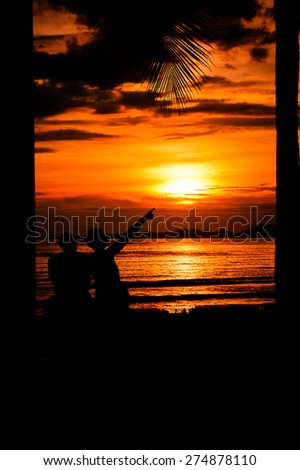 A Silhouette Couple at Sunset - stock photo