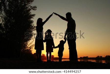 a silhouette of a happy family with children
