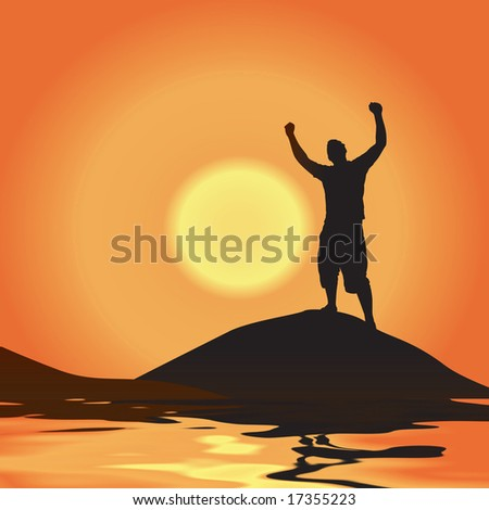 A silhouette of a man atop a mountain with his arms raised up in the air - stock photo