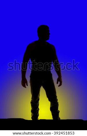 a silhouette of a man standing with his hands by his side.