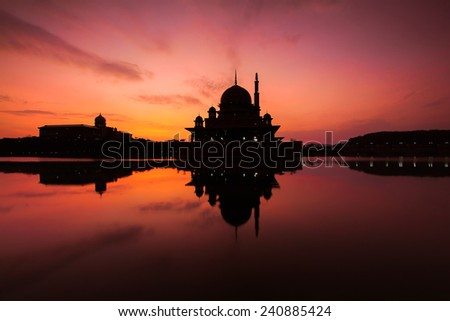 A silhouette of a mosque  - stock photo