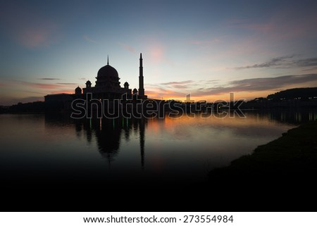 A silhouette of a mosque / The Putra Mosque silhouette  / A mosque at dawn / Sunrise clouds above mosque - stock photo