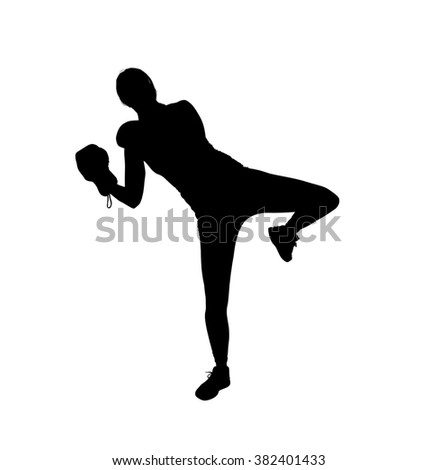 A silhouette of a muscular, athletic female fighting instructor against a white background demonstrating a kicking pose in kickboxing with boxing gloves on.