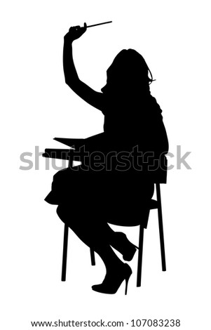 A silhouette of a schoolgirl raising her hand isolated on white background - stock photo