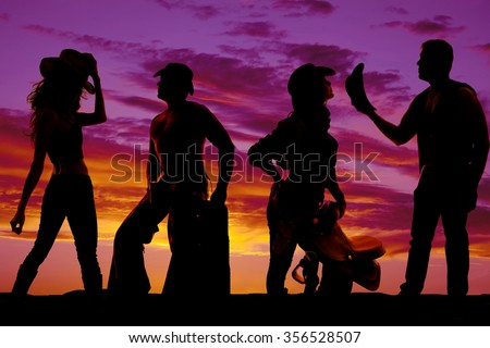 A silhouette of a some cowgirls and cowboys being together.