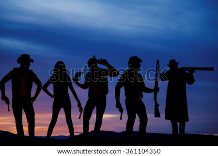 a silhouette of a woman and cowboys with all kinds of guns. - stock photo