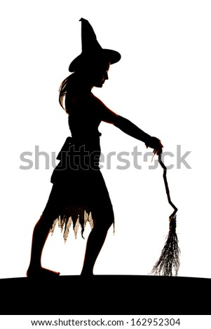 A silhouette of a woman holding her broom and facing sideways.